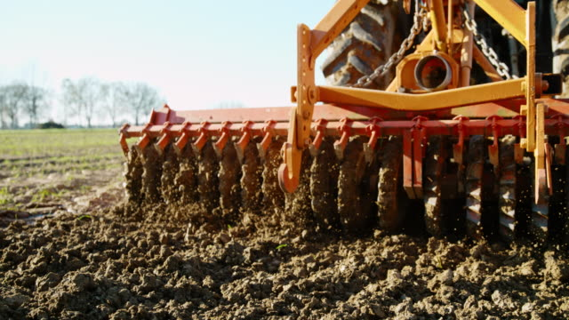 SLO MO Harrowing the field Super slow motion shot of a harrow smoothing and breaking up the soil. harrow agricultural equipment stock videos & royalty-free footage