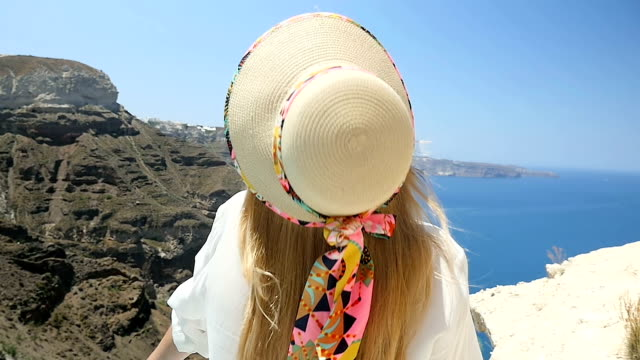 hat falling down & beauty in santorini - cappello video stock e b–roll
