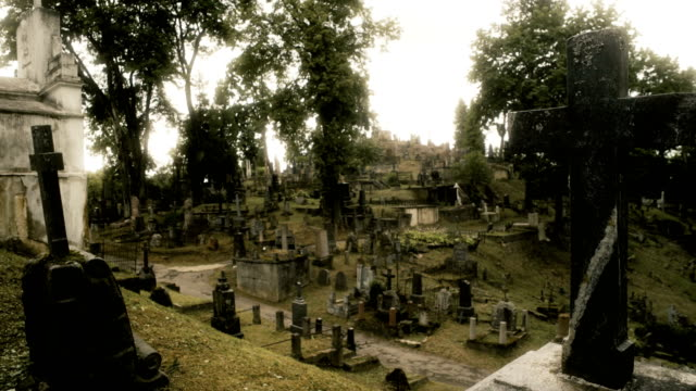 Haunted Cemetery on the Hill Rasos Cemetery is one of the largest and oldest cemetery plots in the region with a spectacular amount of headstones spread across a hill and valley. ghost stock videos & royalty-free footage
