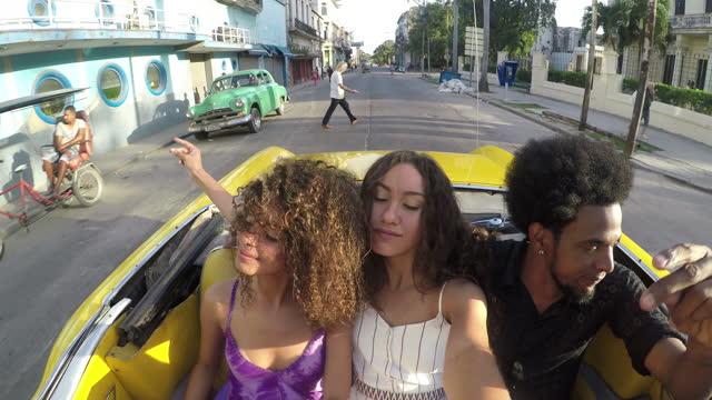 Havana taxi historic downtown old city mixed race friends tourist journey