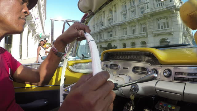 Havana taxi historic downtown old city mixed race tourist journey