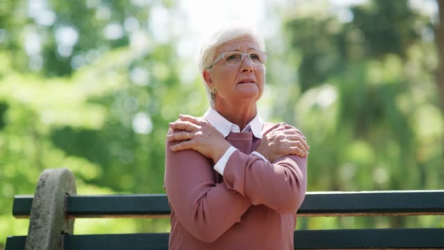 I have no idea where I am 4k footage of a senior woman looking worried while sitting on a bench at the park shivering stock videos & royalty-free footage