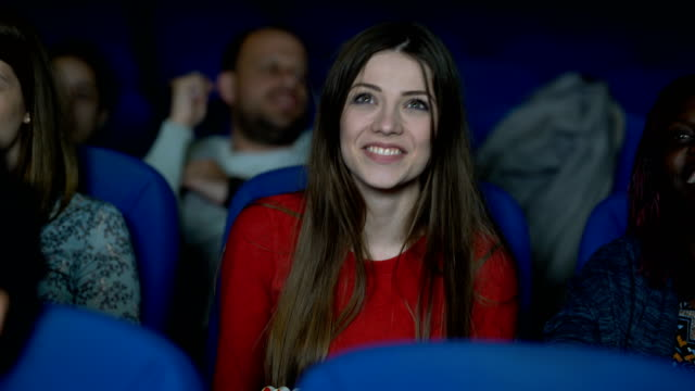 Having A Good Time At The Cinema Young woman at the cinema enjoying a romantic comedy. performing arts event stock videos & royalty-free footage