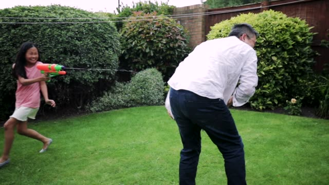 having a water fight with dad - backyard stock videos & royalty-free footage