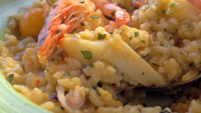 Having meal with sea food risotto video