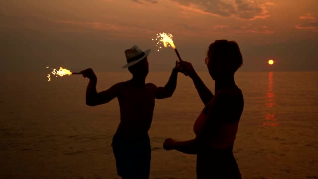 SLO MO Having party with sparklers on the beach video
