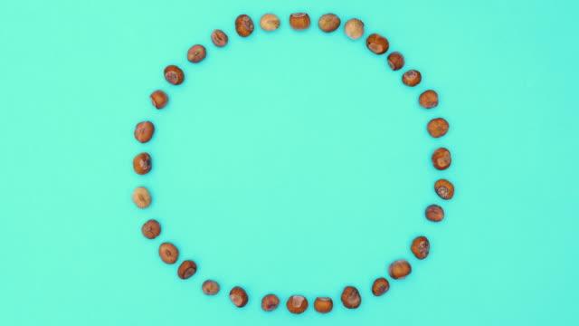 Hazelnut circle moving on green theme. Stop motion