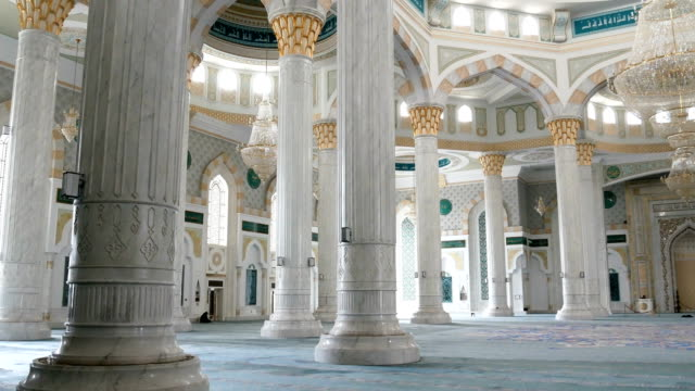 Hazret Sultan Mosque in the city of Nur Sultan. Hazret Sultan Mosque in the city of Nur Sultan. The interior of the mosque, dome and chandelier. kazakhstan stock videos & royalty-free footage