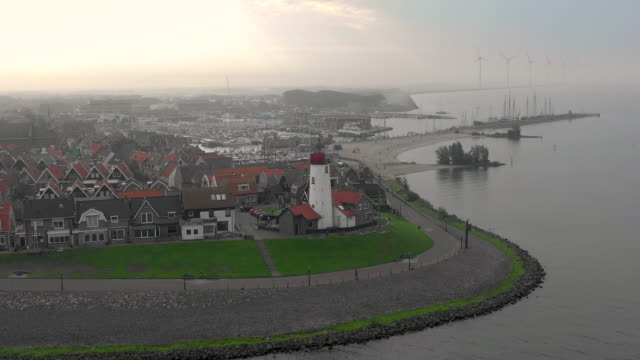 hazy morning aerial view of the town of urk in the netherlands - dutch architecture stock videos & royalty-free footage