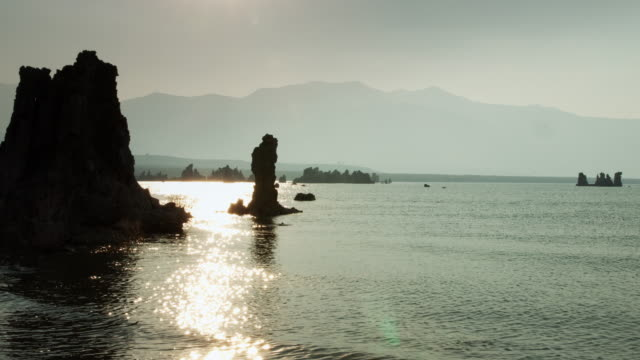 Hazy Mountains and Glittering Water at Mono Lake Tufa video