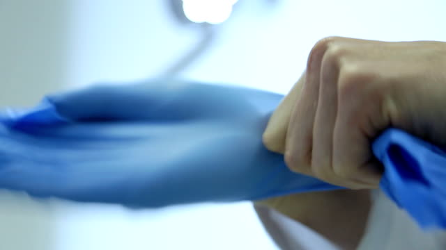 hd: Putting on Surgery Gloves - Stock Video