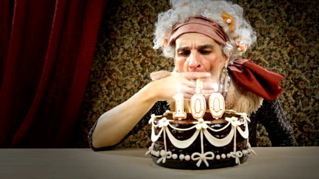 hd video funny senior lighting a cigar  birthday candle video