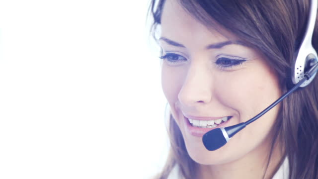 HD1080p30: Customer support phone operator smiling, speaking, looking at camera video