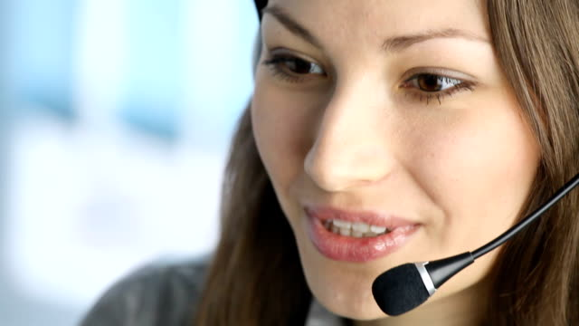 HD1080p30: Customer support phone operator smiling, tripod video