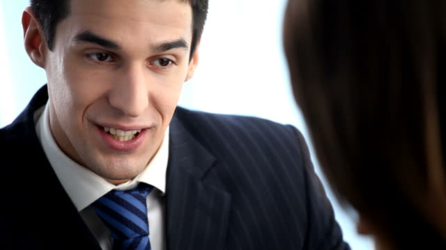 HD1080p30: Two talking businesspeople, tripod video