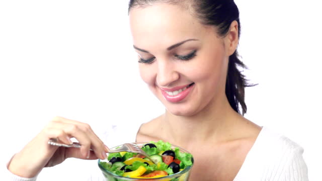 HD1080p30:: Young woman with bowl of vegetarian salad on white video
