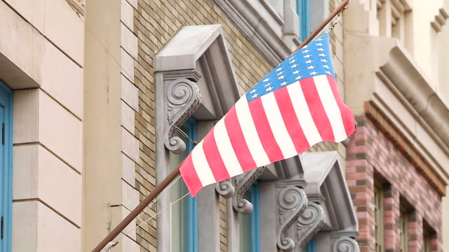 HD:American flag on building background.