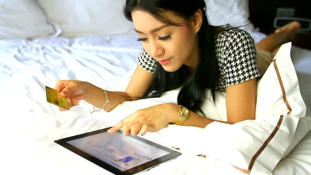 HD:Asian cute women shopping online. video
