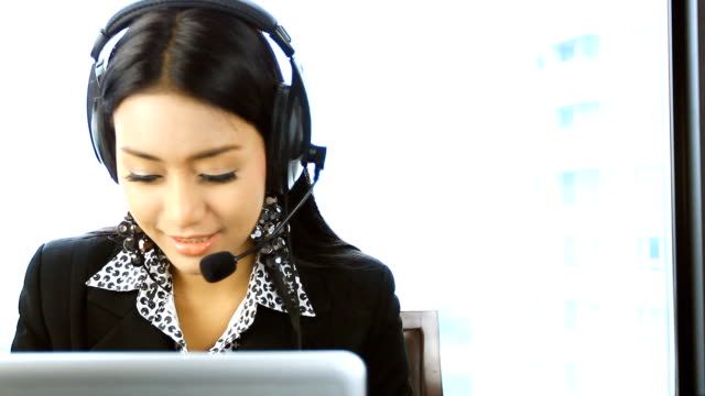 HD:Beautiful asian women operator smile. video