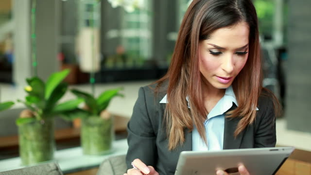 HD:Businesswoman working with digital tablet video