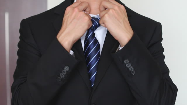HD:Closeup of businessman in black suit correcting a sleeve. video
