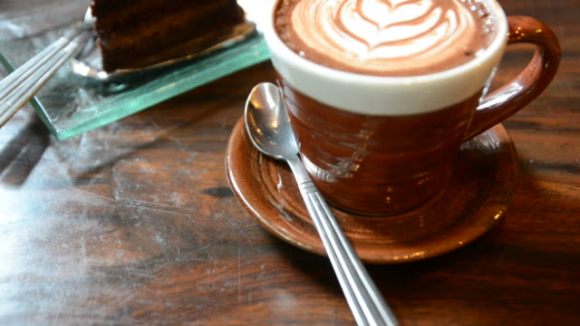 HD:Coffee art with chocolate cake video