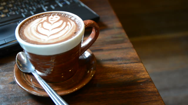 HD:Coffee break for relax time with laptop in coffee shop video