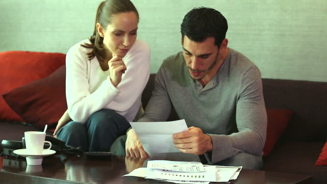 HD:Couple discuss financial difficulties. Couple discuss financial difficulties. mortgages and loans stock videos & royalty-free footage