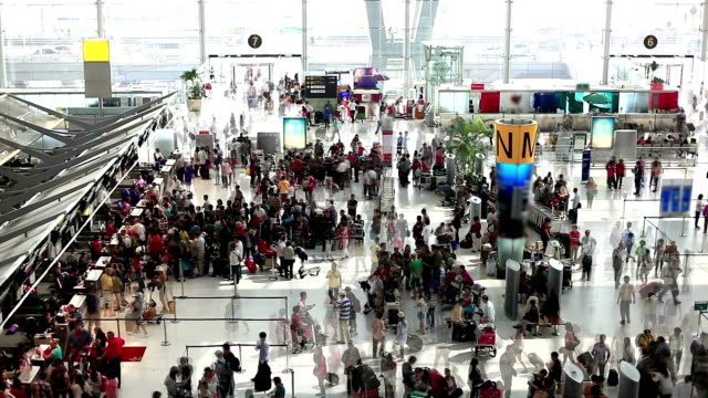 HD:Crowd people waiting in row to check-in at the Airport. video