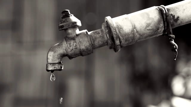 HD:Dripping water from old faucet.