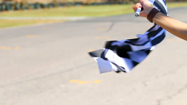HD:Hand of woman waving race flag. video