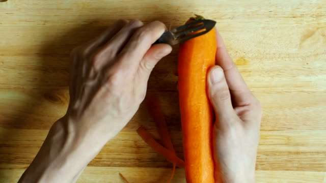 HD:hand peeling carrot chef was peeling  freshness carrot peeled stock videos & royalty-free footage