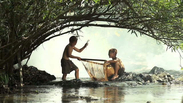 HD:Happy moment for kids enjoyed fishing in waterfall,Thailand video