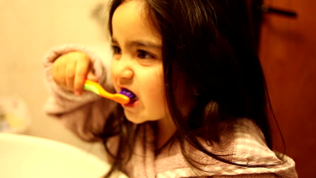 HD:Little Girl Brushing Her Teeth video
