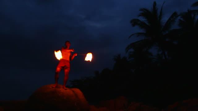 HD:Man perform fire show on the beach.