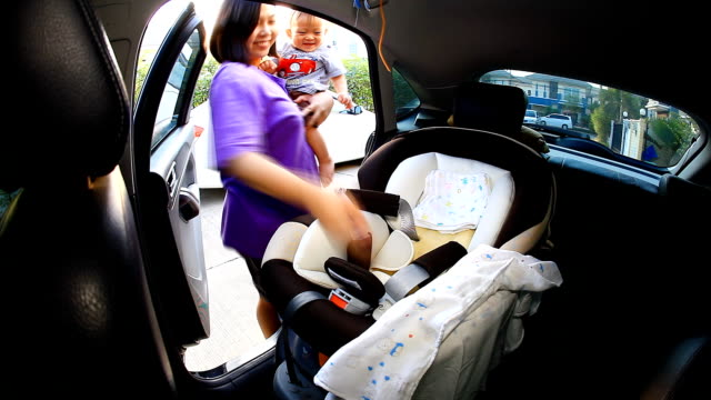 HD:Mother take care her baby on seat belt. video