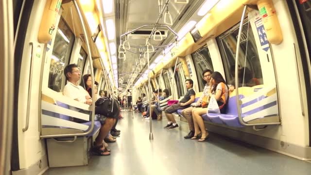 HD:People sitting on underground train. video
