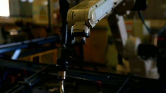 HD:Robotic arm welding in factory. Robot arm welding uses torch to make sparks during manufacture of metal equipment. robot arm stock videos & royalty-free footage