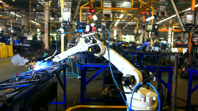 HD:Robotic arm welding.(Timelapse) Robot arm welding uses torch to make sparks during manufacture of metal equipment. robot stock videos & royalty-free footage