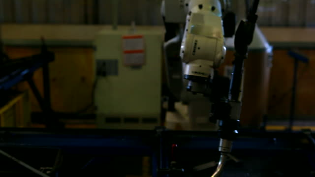 HD:Robotic arm welding. Robot arm welding uses torch to make sparks during manufacture of metal equipment. robot arm stock videos & royalty-free footage