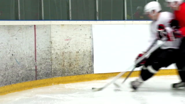 hd:shot of two ice hockey players duelling by the fence - hockey stock videos and b-roll footage