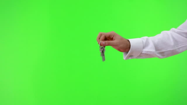 HD:Showing Keys Businessman shows keys on green background car key stock videos & royalty-free footage