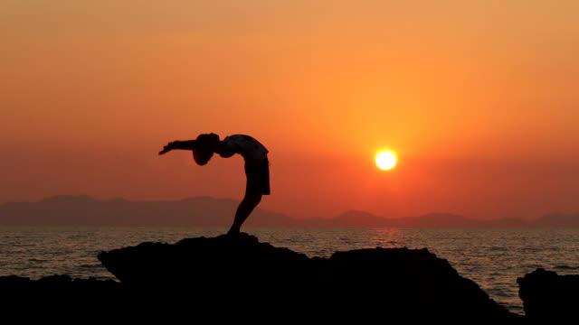 HD:Silhouette of young girl exercise YOGA(Bridge pose modify) video