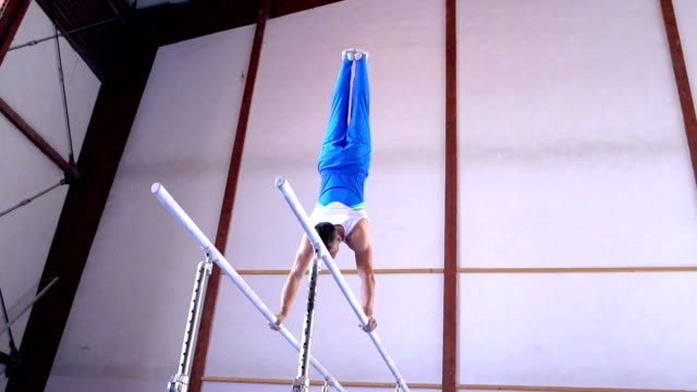HD:Super Slo-Mo Shot of Gymnast Performance on Parallel Bars