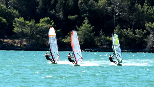 HD:Three male windsurfers in the action video