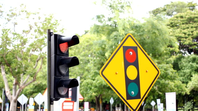 HD:traffic light changing from red to green, from stop to go video