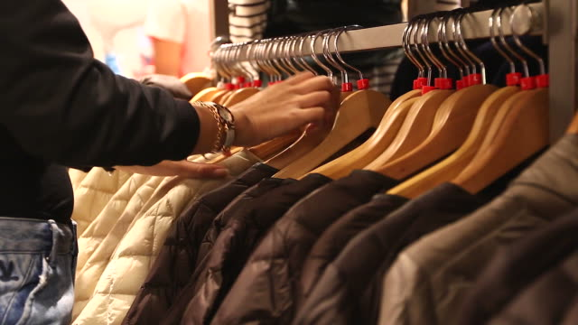 HD:Woman selecting items in a clothes shop. video