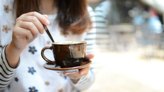 HD:Woman stirring coffee for relax time video