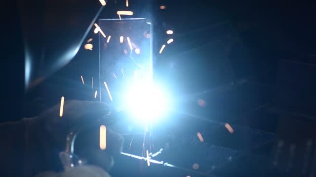 HD:Worker welding metal video