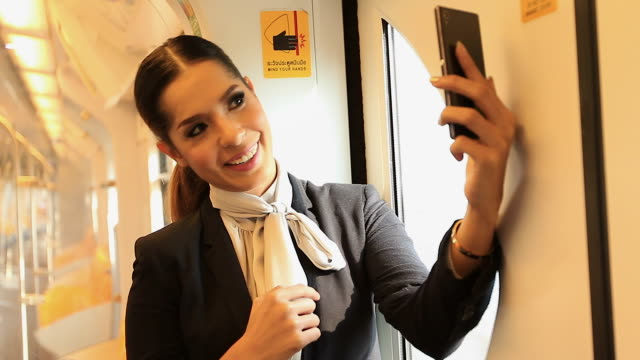 HD:Young attractive woman talking with mobile phone on the train. video